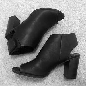 Black open-toe faux leather heels